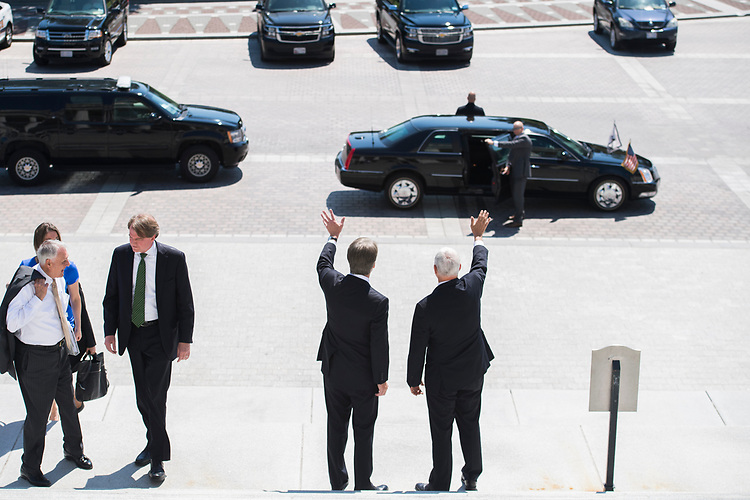 UNITED STATES - JULY 10: Supreme Court nominee Brett Kavanaugh, left, Vice President Mike Pence wave to tourists from the Capitol's Senate steps before a meeting with Senate Majority Leader Mitch McConnell, R-Ky., on July 10, 2018. (Photo By Tom Williams/CQ Roll Call)