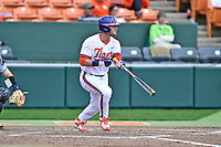 Clemson Tigers left fielder Reed Rohlman (26) swings at a pitch during a game against the Notre Dame Fighting Irish during game one of a double headers at Doug Kingsmore Stadium March 14, 2015 in Clemson, South Carolina. The Tigers defeated the Fighting Irish 6-1. (Tony Farlow/Four Seam Images)