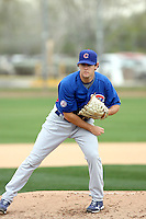 Casey Coleman #27 of the Chicago Cubs participates in pitchers fielding practice during spring training workouts at the Cubs complex on February 19, 2011  in Mesa, Arizona. .Photo by Bill Mitchell / Four Seam Images.