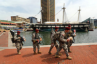 National Guard troopers take a fast food lunch break in Baltimores' inner harbour, with the U.S.S. Constitution, the Worlds oldest floating  commissioned warship, in the background.  April 30, 2015. to go with Nick O'Malley story.  photo by Trevor Collens