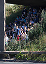 17/06/14 <br /> <br /> A group of school children shelter from the heat of the sun under a motorway bridge after the double decker bus they were travelling in broke down on the hard shoulder of the M6 near Holmes Chapel, Cheshire. A multiple vehicle pile-up on the opposite carriageway closed the motorway in both directions.<br /> <br /> All Rights Reserved - F Stop Press.  www.fstoppress.com. Tel: +44 (0)1335 300098