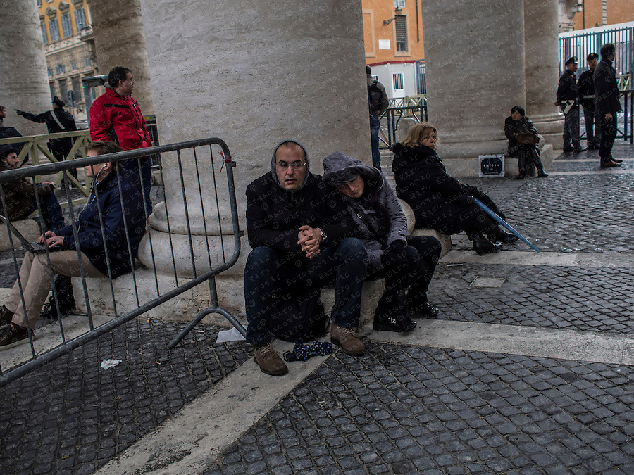 Faithful wait for smoke to rise from a chimney on top of the Sistine Chapel during the second day of voting for the election of a new pope at the Vatican. Picture is taken with a tilt and shift lens.