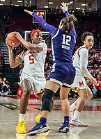 COLLEGE PARK, MD - JANUARY 26: Kaila Charles #5 of Maryland pulls the ball back from Veronica Burton #12 of Northwestern during a game between Northwestern and Maryland at Xfinity Center on January 26, 2020 in College Park, Maryland.