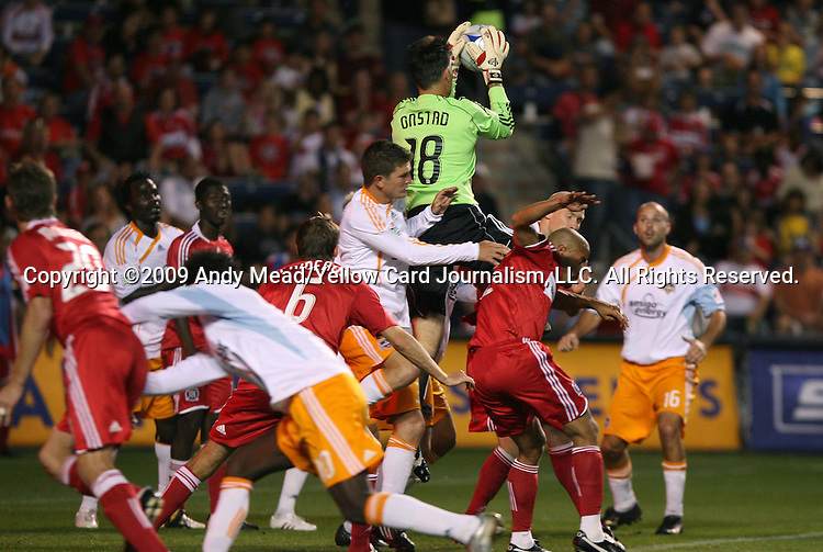 05 June 2009: Houston's Pat Onstad (18) jumps over a crowd to grab the ball. The Houston Dynamo defeated the Chicago Fire 1-0 at Toyota Park in Bridgeview, Illinois in a regular season Major League Soccer game.