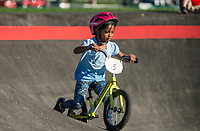 NWA Democrat-Gazette/BEN GOFF @NWABENGOFF<br /> Molly McCourt, 5, of Springdale races Wednesday, Oct. 10, 2018, during the Strider Bikes pump track races at The Jones Center's Runway Bike Park in Springdale. McCourt won the category for children ages 5-6. Children ages 3-6, divided into two age groups, raced head-to-head to see who was the fastest on the balance bikes designed to help young children learn how to ride. It was the first competetive event to use the new pump track that was built to host the Red Bull Pump Track World Championship Final coming up Saturday.