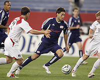 The Revolution's Clint Dempsey looks to get past the defense of MetroStars' Jeff Agoos and Chris Leitch. The New England Revolution defeated the MetroStars 4 to 2 at Gillette Stadium, Foxbourgh, MA, on June 25, 2005.