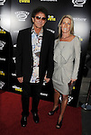 HOLLYWOOD, CA- SEPTEMBER 10: Singer  Mickey Thomas (L) and guest attend 'The Skeleton Twins' Los Angeles premiere held at the ArcLight Hollywood on September 10, 2014 in Hollywood, California.