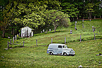 Old gray truck abandoned in a cemetery in rural Blueridge Mountains of West Virginia