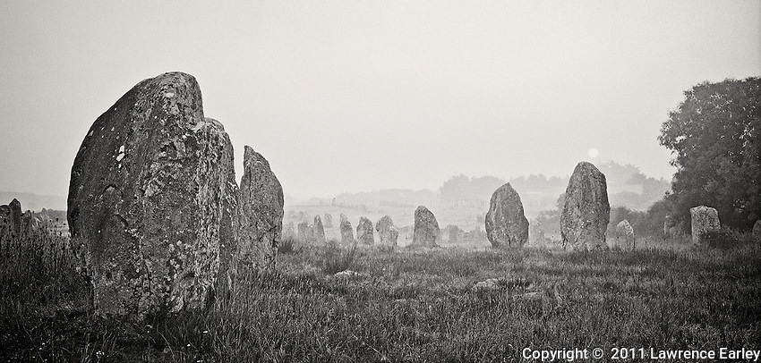 At Carnac in southern Brittany, giant rocks were dragged into miles-long parallel lines known as alignments. This line of megaliths is part of the Menec Alignment.