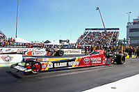 Sep 29, 2013; Madison, IL, USA; NHRA top fuel dragster driver Antron Brown (near) races alongside Clay Millican during the Midwest Nationals at Gateway Motorsports Park. Mandatory Credit: Mark J. Rebilas-