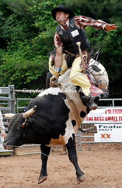Prospect, CT-05, June 2010-060510CM10 Gilberto Barros, of Brazil does his best to hang on, during the Man Vs. Beast bull riding competition.  The event, held at Senior Poncho's in Prospect, featured top PBR riders from the world circuit.  The event will run again Sunday, from 2-4pm and will feature approximately 32 cowboys.  --Christopher Massa Republican-American