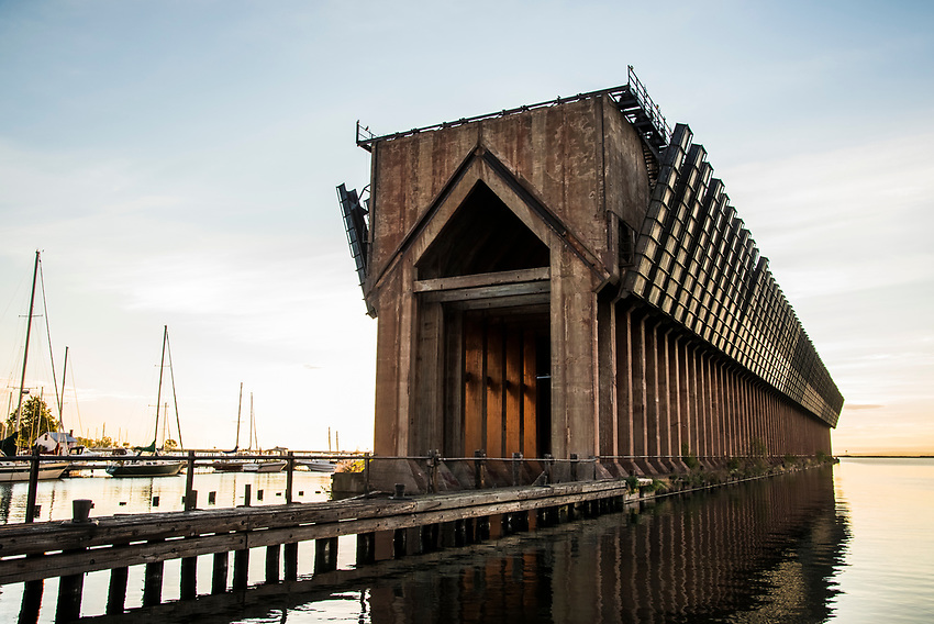 Old dock pilings and the former iron ore loading dock on the Lake Superior waterfront of Marquette, Michigan.