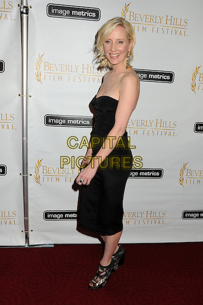 Anne Heche.12th Annual Beverly Hills Film Festival Opening Night held at the AMPAS Samuel Goldwyn Theater, Beverly Hills, California, USA..April 25th, 2012.full length black dress strapless side .CAP/ADM/BP.©Byron Purvis/AdMedia/Capital Pictures.