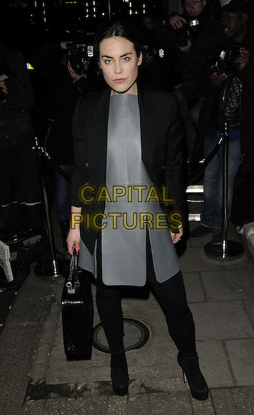 Tallulah Harlech.Harper's Bazaar London Fashion Week a/w 2013 Closing Party, Mark's Club, Charles St., London, England..February 19th, 2013.LFW full length back tights dress blazer slit split ankle boots bag purse  .CAP/CAN.©Can Nguyen/Capital Pictures.