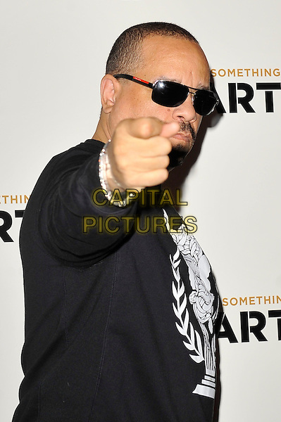 Ice T (Tracy Marrow).'Something For Nothing: The Art of Rap'  European premiere arrivals, Hammersmith Apollo, London, England. 19th July 2012..half length black jumper sweatshirt sunglasses white hand gesture finger pointing  .CAP/MAR.© Martin Harris/Capital Pictures.