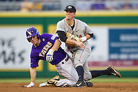 LSU Tigers shortstop Alex Bregman #8 slides into second as Georgia Bulldogs second baseman Jess Posey #23 after turned a double play during the Southeastern Conference baseball game on March 22, 2014 at Alex Box Stadium in Baton Rouge, La. The Tigers defeated the Bulldogs 2-1. (Andrew Woolley/Four Seam Images)