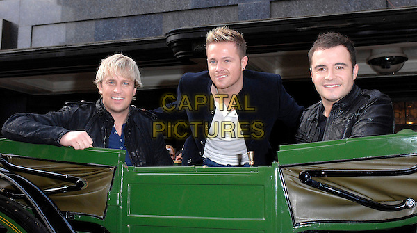 "WESTLIFE - KIAN EGAN, NICKY BYRNE & SHANE FILAN .At Harrods to promote their 9th album ""Back Home"" with signing and performance, London, England..November 5th, 2007.half length black leather jacket blue carriage .CAP/FIN.©Steve Finn/Capital Pictures."