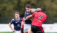 Sami Fisilau of Jersey gets to grips with Jason Harries of London Scottish during the Greene King IPA Championship match between London Scottish Football Club and Jersey at Richmond Athletic Ground, Richmond, United Kingdom on 7 November 2015. Photo by Andy Rowland.