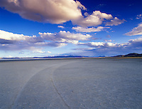 Cracked bed of Alvord Desert with clouds. Oregon