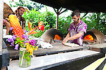 Maui, Hawaii.  Hana Farms, located just outside of the town of Hana, is a community farm that grows a variety of organic produce, flowers and herbs.  On Friday and Saturday nights, they offer Clay Oven Pizzas, made on site and wrapped in a Helicaonia Leaf if you get your order to go.  The pizza is offered from 4pm - 8pm on Friday and Saturday nights.  Otherwise, the fruit stand is open most days of the week and offers a variety of tropical fruits, home made breads and other island treats.