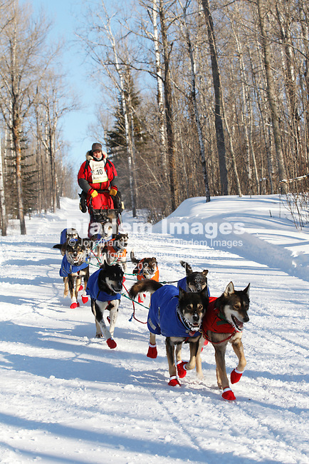 DULUTH, MN - FEBRUARY 2:  Nathan Schroeder and his dog team race down a hill a few minutes from the finish line of the John Beargrease sled dog marathon February 2, 2011 in Duluth, Minnesota.  After3 days of racing over hundreds of miles Schroeder finished in second place 20 seconds behind winner Ryan Anderson.  (Photograph by Jonathan P. Larsen)
