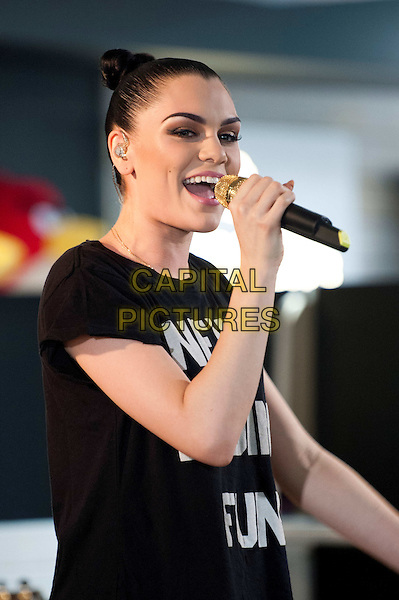 Jessie J (Jessica Ellen Cornish) on stage for the first in a series of events as part of the Music is GREAT week, HMV Oxford Circus, London, England..May 14th, 2012.in concert live gig performance performing half length singing black hair up bun.CAP/BF.©Bob Fidgeon/Capital Pictures.
