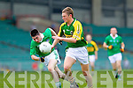 Michael Brennan breaks away from Limerick's Eddie Mulcahy in the Munster Junior Championship Semi final held in the Gaelic Grounds last Saturday.