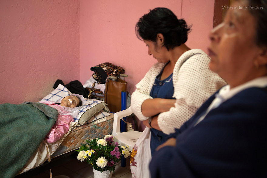 Reynita's adoptive daughter (C) and a friend (R) mourn Reynita, a resident of Casa Xochiquetzal, who died at the shelter in Mexico City, Mexico on October 18, 2010. Casa Xochiquetzal is a shelter for elderly sex workers in Mexico City. It gives the women refuge, food, health services, a space to learn about their human rights and courses to help them rediscover their self-confidence and deal with traumatic aspects of their lives. Casa Xochiquetzal provides a space to age with dignity for a group of vulnerable women who are often invisible to society at large. It is the only such shelter existing in Latin America. Photo by Bénédicte Desrus