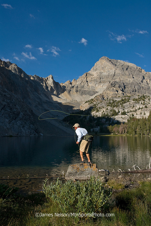 A angler casts a fly for trout on an alpine lake in the Lost River Range of Idaho.