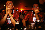 'ENGLAND'S WORLD CUP 1998', FANS SHOW THEIR DISAPPOINTMENT AFTER LOSING TO ARGENTINA TO GO OUT OF THE CUP. SPORTS CAFE, LONDON, 1998