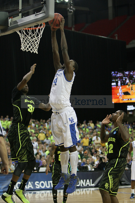 UK freshman forward Michael Kidd-Gilchrist puts up a slam dunk during the first half of the UK vs. Baylor South Regional Finals at the Georgia Dome in Atlanta,  March 25, 2012. Photo by Brandon Goodwin | Staff