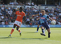 Wycombe Wanderers' Adam El-Abd clears despite the attentions of Blackpool's Joe Dodoo<br /> <br /> Photographer Kevin Barnes/CameraSport<br /> <br /> The EFL Sky Bet League One - Wycombe Wanderers v Blackpool - Saturday 4th August 2018 - Adams Park - Wycombe<br /> <br /> World Copyright &copy; 2018 CameraSport. All rights reserved. 43 Linden Ave. Countesthorpe. Leicester. England. LE8 5PG - Tel: +44 (0) 116 277 4147 - admin@camerasport.com - www.camerasport.com