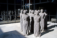 "The ""Petrified"" a group of shrouded, life-size figures by Swiss artist Carl Bucher denouncing the violation of human rights at the entrance of the Museum of the International Red Cross in Geneva."
