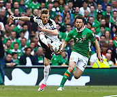 June 11th 2017, Dublin, Republic Ireland; 2018 World Cup qualifier, Republic of Ireland versus Austria;  Florian Kainz of Austria clears the ball forward from Harry Arter of Ireland
