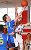 Steve Torre #12 of Kellenberg, left, tries to get a finger roll past  looks to stay ahead of Tanner Owens #10 of Long Beach during a non-league varsity boys' basketball game at Freeport High School on Monday, Jan. 18, 2016. Kellenberg won by a score of 71-62.