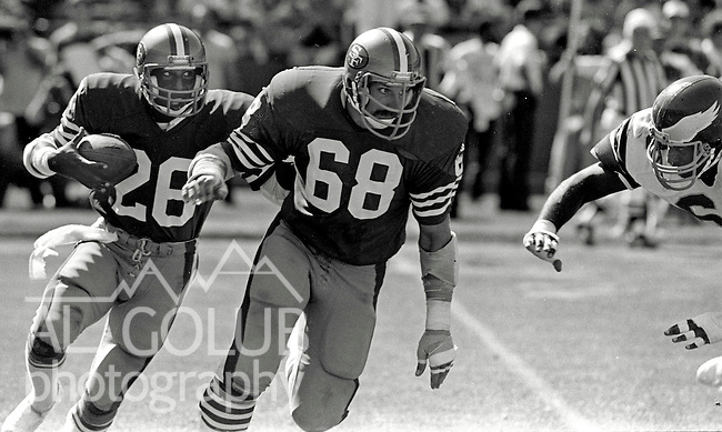 San Francisco 49ers vs. Philadelphia Eagles at Candlestick Park Sunday, September 3, 1983..Eagles beat 49ers 21-17.San Francisco 49ers Guard John Ayers (68) blocking for 49ers Running Back Wendell Tyler (26)...