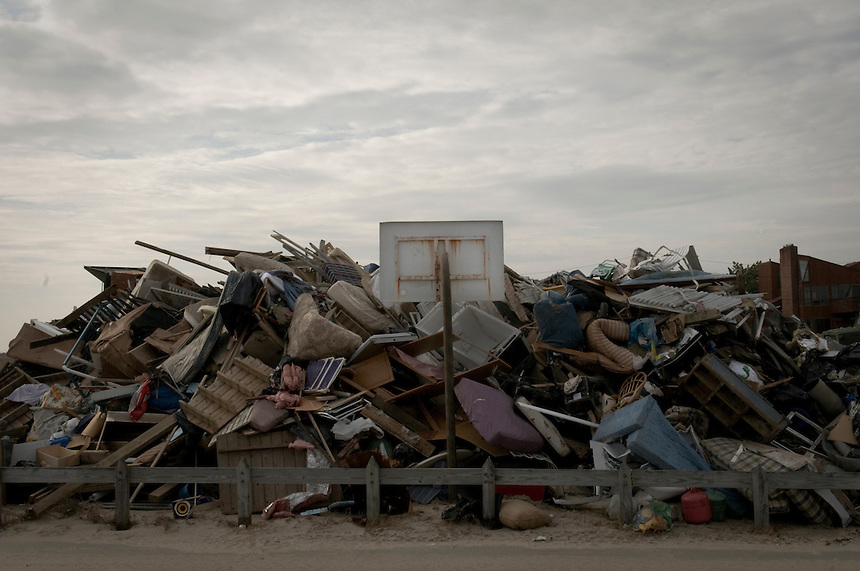 Debris from the destroyed during Hurricane Sandy house stored next to a basketball loop in the village of Breezy Point, New York. More than 80 homes were destroyed and 110 burned to the ground this night.