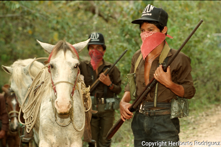 Zapatista rebel Subcomandante Marcos heads troops while riding on a road in the Lacandonian jungle in southern state of Chiapas, March 22, 1994.  Photo by Heriberto Rodriguez