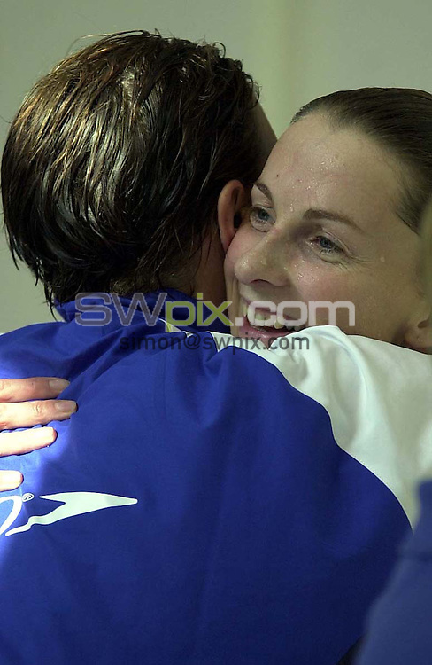 Pix: Simon Wilkinson/SWpix.com. Swimming. Scottish National Open and Youth Championships, Tollcross Leisure Park, Glasgow 24/06/2001...COPYWRIGHT PICTURE>>SIMON WILKINSON>>01943 436649>>..50 meters butterfly...Record Breaker...Alison Sheppard hugs t Karen Pickering after breaking the Scottish record and qualifying for the World Championships in Japan in July.