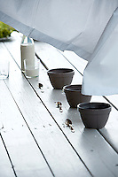 Three bowls in a row on the rustic garden table