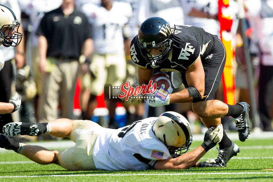 Michael Campanaro (3) of the Wake Forest Demon Deacons looks for extra yards after making a catch against the Army Black Knights at BB&T Field on September 22, 2012 in Winston-Salem, North Carolina.  The Demon Deacons defeated the Black Knights 49-37.  (Brian Westerholt/Sports On Film)