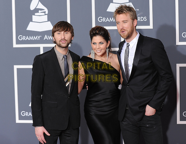 LADY ANTEBELLUM - Dave Haywood, Hillary Scott & Charles Kelley.Arrivals at the 52nd Annual GRAMMY Awards held at The Staples Center in Los Angeles, California, USA..January 31st, 2010.grammys half length grey gray suit black dress one shoulder.CAP/RKE/DVS.©DVS/RockinExposures/Capital Pictures