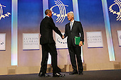 President Barack Obama, who is in New York City for the 69th Session of the United Nations General Assembly, shakes hands with Bill Clinton on stage at the Clinton Global Initiative on September 23, 2014 in New York City. World leaders, activists and protesters have converged on New York City for the annual UN event that brings together the global leaders for a week of meetings and conferences. This year 's General Assembly has highlighted the problem of global warming and how countries need to strive to  reduce greenhouse gas emissions. <br /> Credit: Spencer Platt / Pool via CNP
