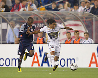 Pumas UNAM forward Martin Bravo (10) dribbles as New England Revolution midfielder Sainey Nyassi (17) pressures. The New England Revolution defeated Pumas UNAM in SuperLiga group play, 1-0, at Gillette Stadium on July 14, 2010.