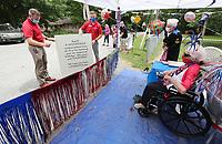 Personnel with the Lewis Automotive Group bring Rita Miller (right), 100, a giant birthday card Tuesday, June 23, 2020, as they participate in a surprise birthday parade in her honor. Miller is a World War II veteran that served in the Army Nurse Corp. The surprise parade included friends, family and the city of Fayetteville Fire and Police Departments. Miller also received recognition from local, state and national officials. Check out nwaonline.com/200624Daily/ and nwadg.com/photos for a photo gallery.<br /> (NWA Democrat-Gazette/David Gottschalk)