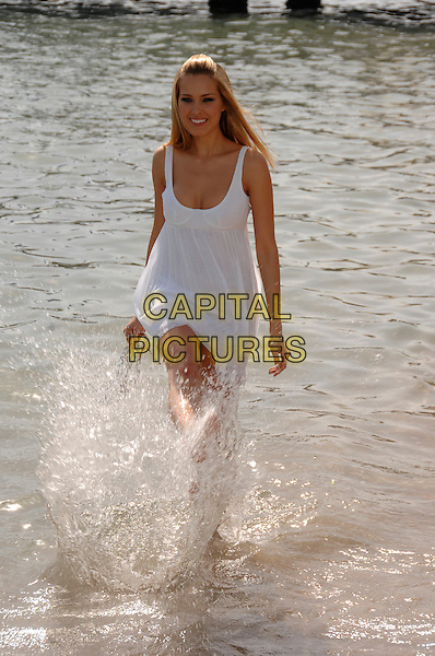 "PETRA NEMCOVA.""Fashion TV Supermodels 2008"" calendar launch at the 60th International Cannes Film Festival, Cannes, France.  .May 24th, 2007.full length white summery dress water kicking gesture.CAP/PL.©Phil Loftus/Capital Pictures"