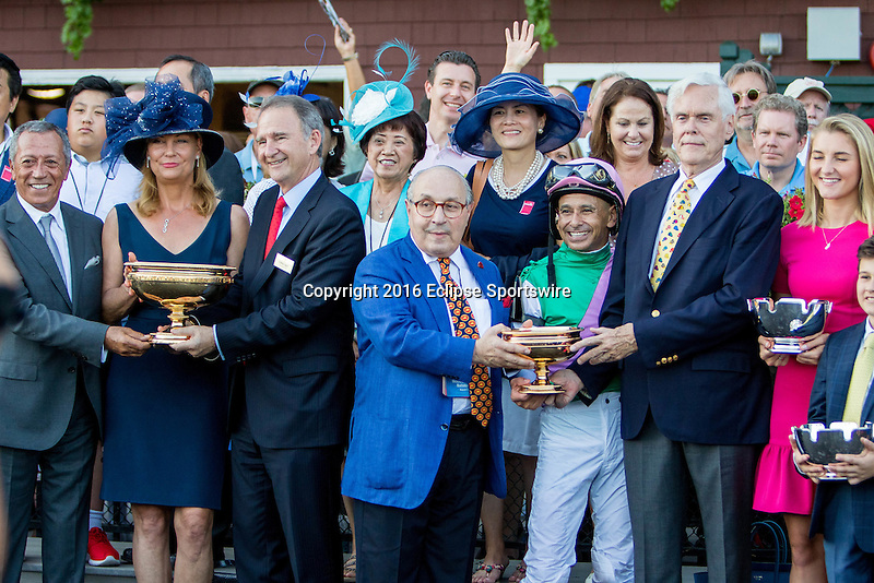SARATOGA SPRINGS - AUGUST 27: Jockey Mike Smith stands with the Arrogate #1 (not pictured) connections in the winner's circle after winning the the Travers Stakes on Travers Stakes Day at Saratoga Race Course on August 27, 2016 in Saratoga Springs, New York. (Photo by Sue Kawczynski/Eclipse Sportswire/Getty Images)
