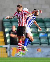 Lincoln City's Neal Eardley vies for possession with Sheffield Wednesday's Marco Matias<br /> <br /> Photographer Chris Vaughan/CameraSport<br /> <br /> Football Pre-Season Friendly - Lincoln City v Sheffield Wednesday - Friday 13th July 2018 - Sincil Bank - Lincoln<br /> <br /> World Copyright &copy; 2018 CameraSport. All rights reserved. 43 Linden Ave. Countesthorpe. Leicester. England. LE8 5PG - Tel: +44 (0) 116 277 4147 - admin@camerasport.com - www.camerasport.com