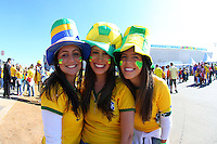 Three female Brazil fans soak up the atmosphere outside the Itaquerao stadium ahead of kick off in the opening match of the 2014 World Cup vs Croatia
