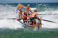 The Long Reef surf rescue boat, rowed by women, heads out through the surf in the annual Queenscliff surf carnival.